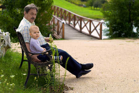 Grandfather and  boy spend time together in the park. Stock Photo - 1414200