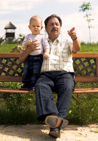 Grandfather and  boy spend time together in the park. Stock Photo - 1414175
