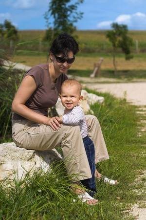 and mother together outdoor, full length portrait. photo