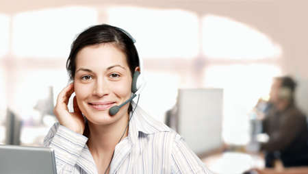 telework: Young and kind female customer cervice representative at an IT company. Stock Photo