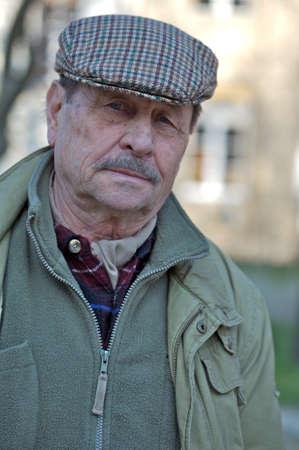 Outdoor portrait of a senior man, europian style. Stock Photo - 1414232