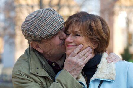 Happy senior couple kiss each other. Stock Photo - 1414286