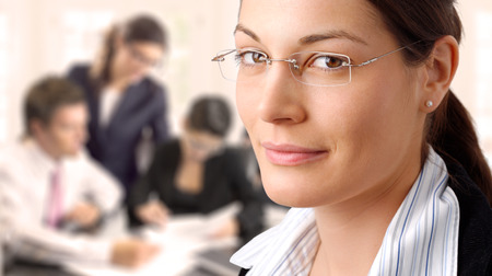 Businesswoman and her team Stock Photo - 1414274