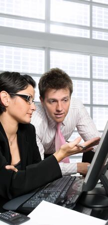 Young office workers are brainstorming in front of a computer screen. Stock Photo - 1422625