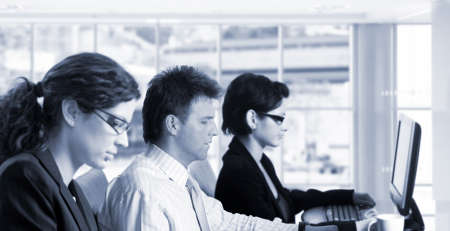 Young office workers are sitting in front of their computer screens. Stock Photo - 1414143