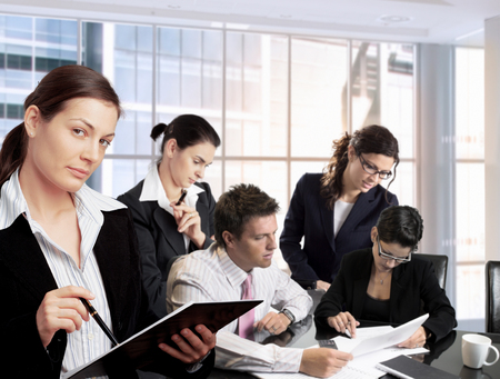 Young businesspeople work together in office. Daylight, indoor, office.  Stock Photo - 1414241