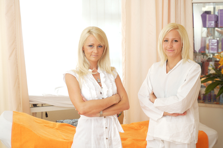 womanliness: Portrait of attractive female beauticians in the beauty-salon. Stock Photo