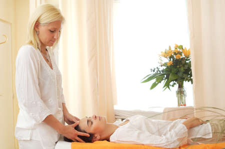 womanliness: Beautician massages patient in the beauty salon.
