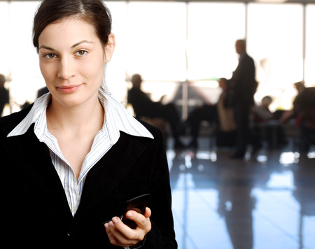 Succeful young businesswoman is posing in the lobby. photo
