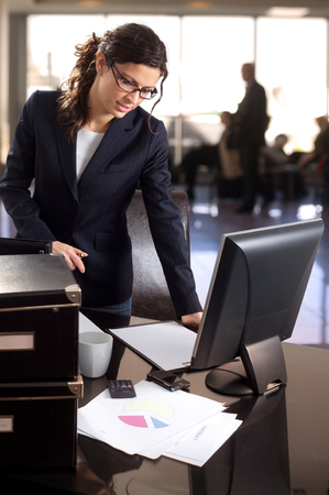 Young businesswoman works in the lobby of the bank. Stock Photo