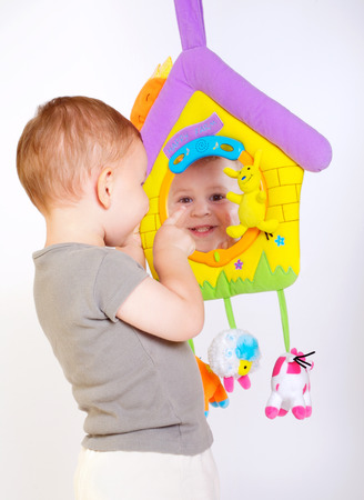 two year old: Two year old  boy enjoys playing with toys. Studio Shot. All toys visible on the photo are officialy property released.