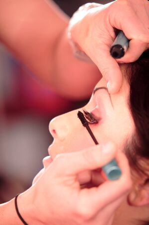 beauty parlour: Close up of beautician creating makeup for a young women in the beauty parlour.