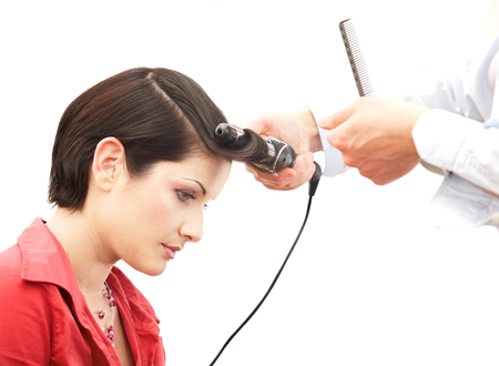 Beautiful young woman gets a hairdo in the beauty-shop. Stock Photo - 1414158