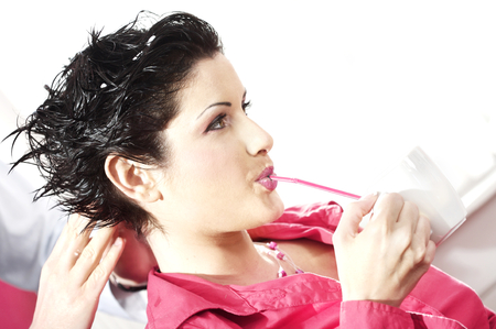womanliness: Beautiful young woman gets a hairdo in the beauty-shop.