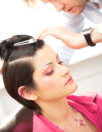 Beautiful young woman gets a hairdo in the beauty-shop. Stock Photo - 1414169