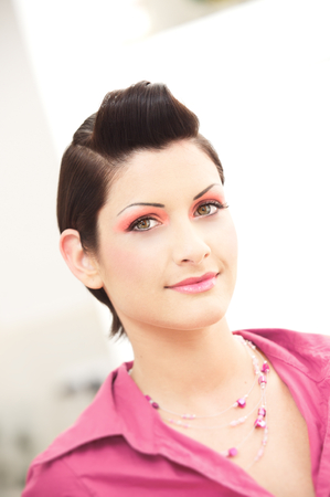 womanliness: Beautiful young woman looks into the camera. Stock Photo