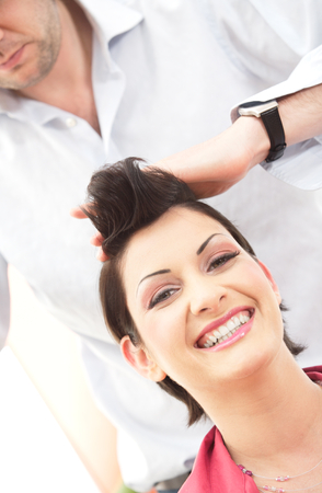 Beautiful young woman gets a hairdo in the beauty-shop. Stock Photo - 1414304