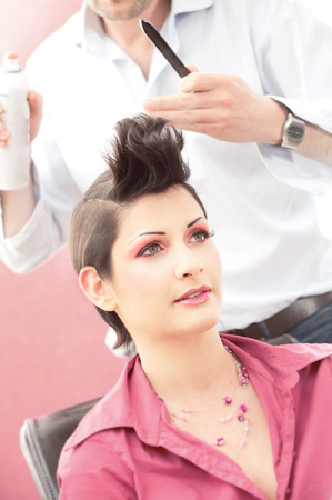 Beautiful young woman gets a hairdo in the beauty-shop. Stock Photo - 1414183