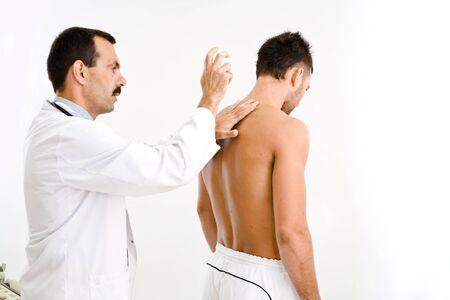 Doctor examining young male patient.  Stock Photo - 1575695