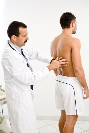 Doctor examining young male patient.  Stock Photo - 1575701