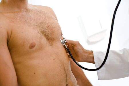heart doctor: Doctor examining young male patient. Closeup.
