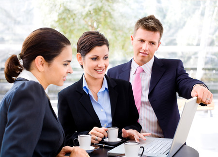 Businessteam of three having discussion over a coffee table. Stock Photo - 1674018