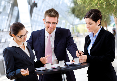 Businessteam of three having discussion over a coffee table. Stock Photo - 1674015