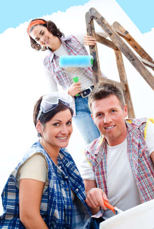 domestic task: Young couple and friend improving their home.  Stock Photo
