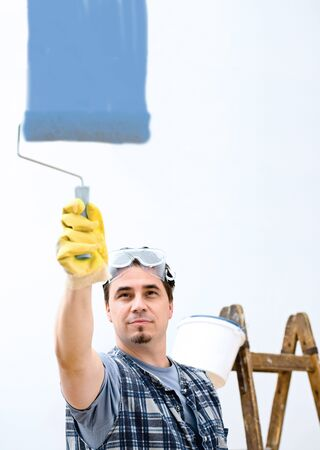 domestic task: Worker painting the wall. Stock Photo