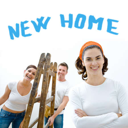 domestic task: Young couple and friend improving their new home.  Stock Photo