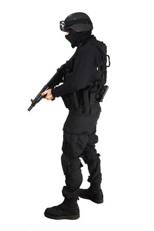 police unit: Special force soldier in black tactical suit.