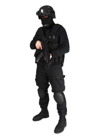 Special force soldier in black tactical suit. photo