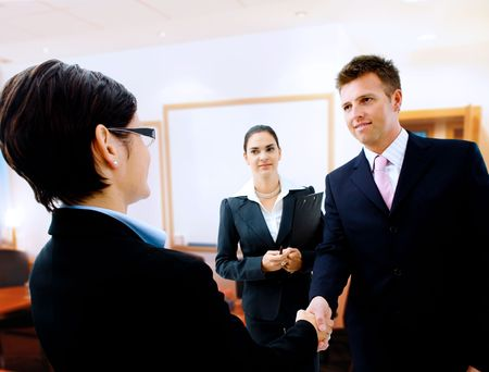 Businessman greeting partner in the meeting room. Selective focus is placed on the hands. Stock Photo - 1809602