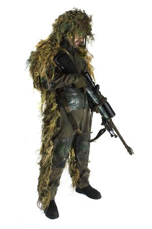 Sniper is wearing a ghillie suit. photo