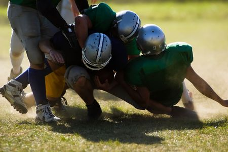football kick: Football players are is serious action.