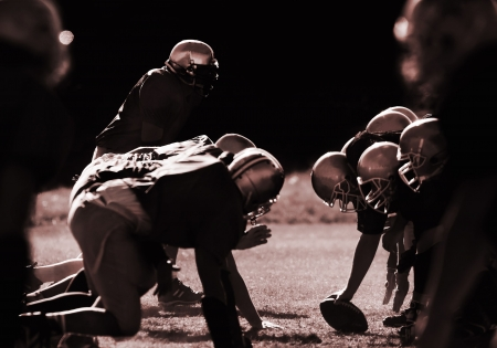 football players: Football players are ready to start.