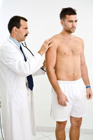 Doctor examining young male patient. Stock Photo - 1989226