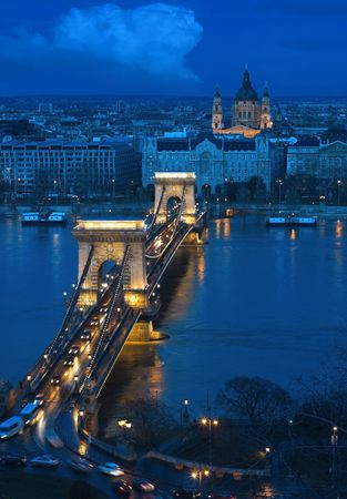 on both sides: Budapest, the capital of Hungary is one of the nicest cities. It lies on both sides of the river Danube. The old Chain Bridge is one of the most remarkable landmarks of the city.