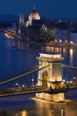 both sides: Budapest, the capital of Hungary is one of the nicest cities. It lies on both sides of the river Danube. The old Chain Bridge and the Parliament are famous landmarks of the city. Stock Photo