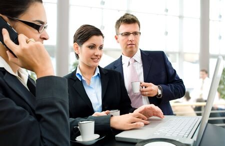 Businesspeople having discussion over the coffee table. Stock Photo