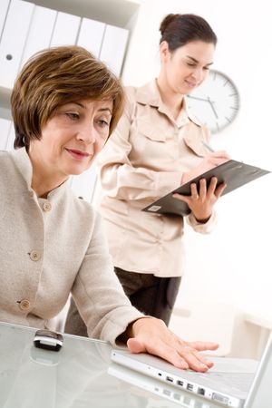 Senior businesswoman and young assistant working in office. Stock Photo - 2021547