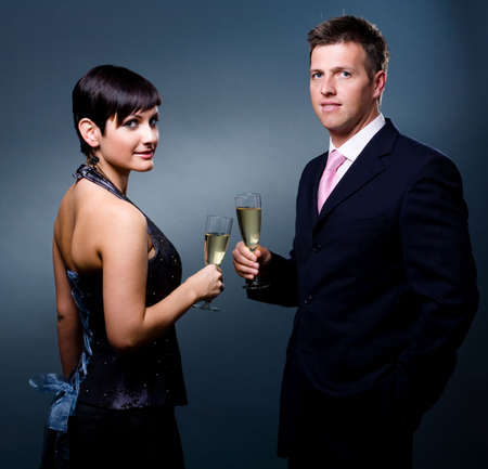 Couple drinking champagne on a party. photo