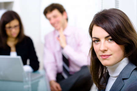 Businesswman and team working in office. Stock Photo - 2139581