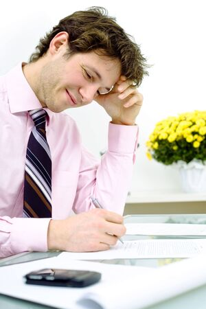 Young businessman working in office, smiling. Vertical version. Stock Photo - 2139603