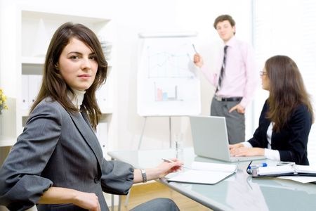 Young business people watching presentation in  board room. Stock Photo - 2139597