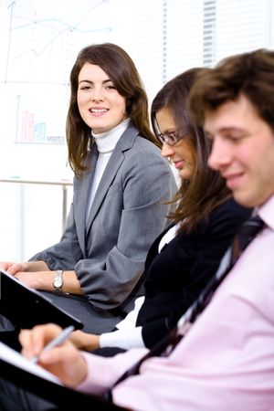 Young businesspeople making notes during the presentation. Stock Photo - 2139594