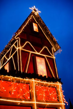 pineal: House in Christmas decoration, outdoor, nightshot. Stock Photo
