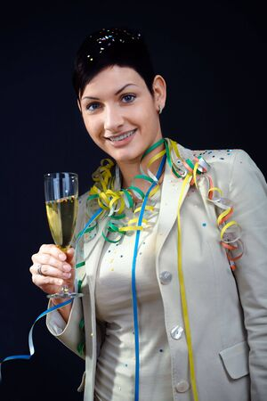 Young women with champagne fulte in hand. photo