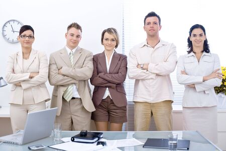 businessmeeting: Group of five young business people lining up for a team portrait. Stock Photo