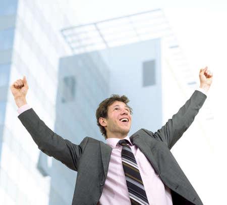 successfull: Happy businessman celebrating success, outdoor. Stock Photo